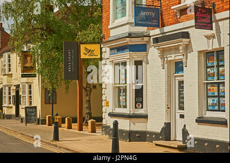 A street scene in Stratford upon Avon, Warwickshire with different businesses in the street. - Stock Image