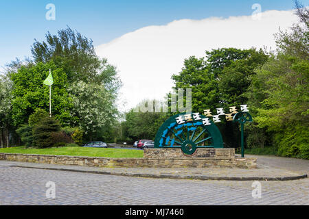 Waterwheel sculpture by David Kemp at the entrance to Burrs Country Park, Bury, installed in 1996. The Waterwheel was commissioned by Bury Council. - Stock Image