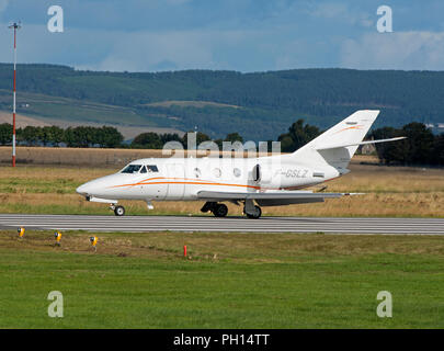 A new arrival at Inverness Dalcross Airport in the Scottish Highlands is this French built Dassault Falcon 100. - Stock Image
