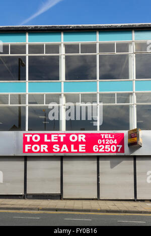 Empty offices and retail units  to let or for sale on Bradshagate, Bolton. Typical office architecture of the mid - Stock Image
