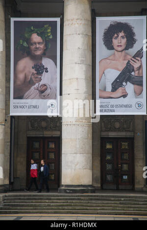 Warsaw, Poland, 11 November 2018: celebrations of Polish Independence Day. People with Polish flag in front of theater building and theater posters - Stock Image