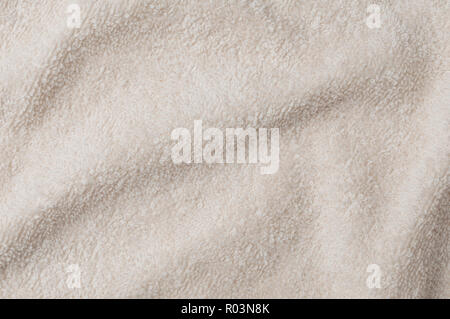 Fluffy clear brown towel top view, texture background - Stock Image