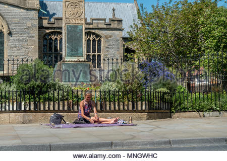 A fortune teller laying out her Tarot Cards in the High Street, Glastonbury, Somerset, UK - Stock Image