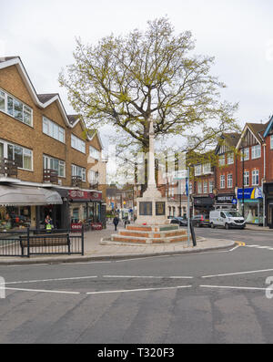 The town centre and war memorial at the junction of Green Lane and Maxwell Road, Northwood, Middlesex, England, UK - Stock Image