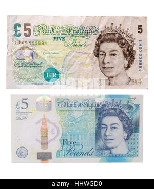 An old paper British five pound note above a new polymer, or plastic, £5 note - Stock Image