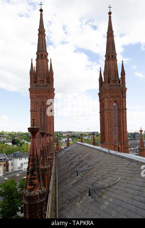Spires and roof of the Marktkirche (Market Church) in Wiesbaden, the state capital of Hesse, Germany. - Stock Image