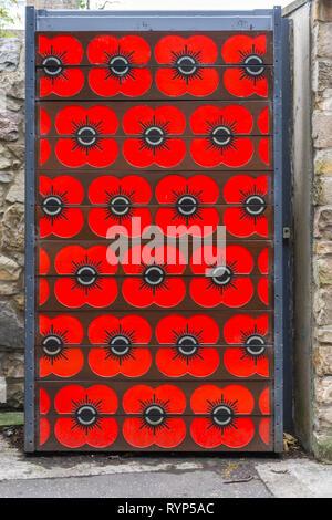 Poppy decorated flood gate, Water of Leith flood prevention scheme, beside Lady Haig's Poppy Factory, Edinburgh, Scotland, UK - Stock Image