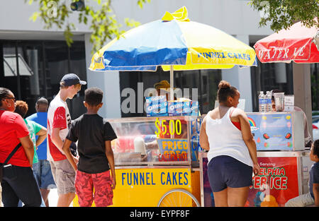 American junk food. Food vendor selling funnel cakes at a 4th of July celebration event in Greensboro, North Carolina. - Stock Image