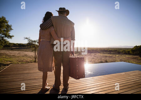 Couple standing together on wooden plank during safari vacation - Stock Image