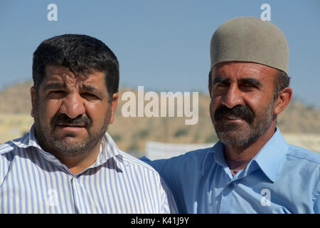 Iranian men, Chaharmahal & Bakhtiari province, Iran. In ancient times, Median civilians and officers covered their heads with felt caps - Stock Image