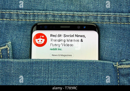 MONTREAL, CANADA - December 23, 2018: Reddit logo and android app on Samsung s8 screen in a blue jeans pocket. Reddit is an American social news aggre - Stock Image