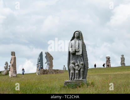 Stz Koupaia granite sculpture in the Valley of the Saints, Quenequillec, Brittany, France. - Stock Image