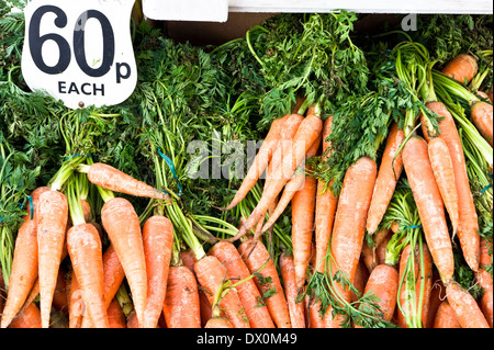 Fresh organic carrots for sale at a market in the UK - Stock Image
