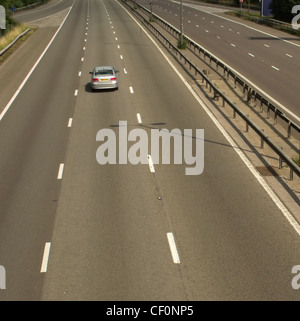 Single car on M1 at Watford Gap services, M1 Motorway, Northamptonshire, England UK - Stock Image