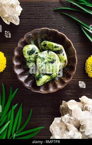 Nephrite Jade with Smoky Quartz and Mums on Dark Wood - Stock Image
