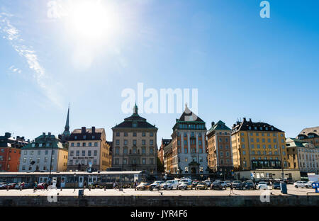 View of Skeppsbron, Gamla Stan, Stockholm, Sweden. Pretty quayside buildings on a sunny day. - Stock Image