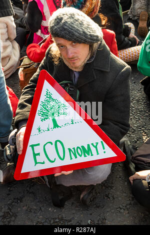 Westminster bridge, London, UK. 17th November 2018. . Extinction Rebellion ÔRebellion DayÕ. Protestors opposed to what they see as a government of climate criminals aiming to gather together enough protesters to close down parts of London, by shutting down fossil-powered road traffic at key pinch-points in London. Here at Westminster Bridge protestors sat in the road blocking the bridge to traffic. Credit: Stephen Bell/Alamy Live News - Stock Image