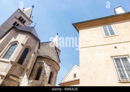 Prague Castle , the Basilica of St. George . Towers Adam and Eve, Czech Republic - Stock Image