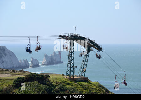 The chairlift at Alum Bay with the Needles Rocks and Lighthouse jutting out into the Solent on the Isle of Wight. - Stock Image