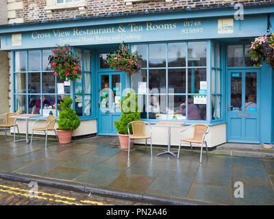 Cross View Café and Tea Rooms overlooking the stone cross in the Market place in Richmond North Yorkshire England UK - Stock Image