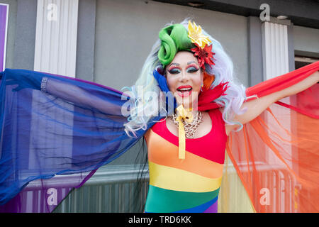 Portrait of a trans performer with big hair at the 2019 Queens Pride Parade in Jackson Heights, NYC. - Stock Image