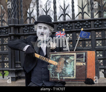 London, UK. 27th March 2019, Brexit protester clowning around dressed as Charlie Chaplin Credit: Ian Davidson/Alamy Live News - Stock Image