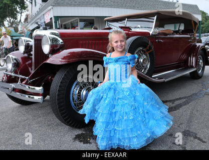 Mia Simoncini, 7, of Clinton poses for a picture after marching in the parade during the Clinton town 350th anniversary - Stock Image