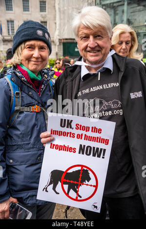 Stanley Johnson at a stop trophy hunting and ivory trade protest rally, London, UK. Save the Asian elephant shirt slogan and placard - Stock Image