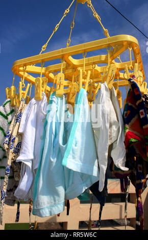 Many colorful Reusable Diapers drying outside in the sun - Stock Image