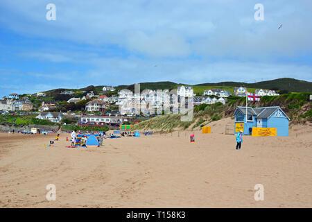 People enjoying the seafront at Woolacombe Beach, Woolacombe Bay, Devon, UK - Stock Image