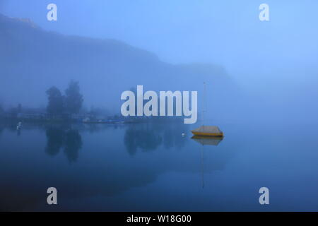 Misty summer morning at Lake Brienz, Switzerland. - Stock Image
