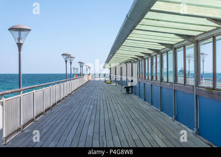 Bournemouth, UK. 22nd June 2018. A view down Boscombe pier in Bournemouth. Thomas Faull/Alamy Live News - Stock Image