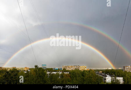 Double rainbow in the sky after summer rain storm on August 7, 2018. Moscow, Russia. - Stock Image