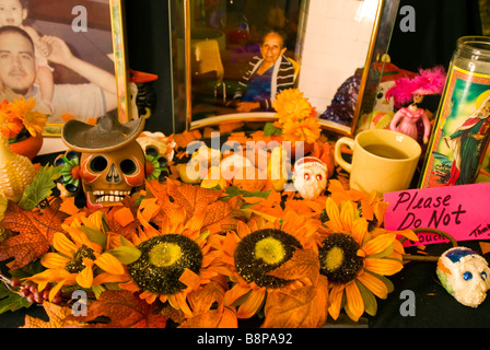 Day of the Dead altar showing skulls large sunflowers and photograph of older woman Mexican religious custom San - Stock Image