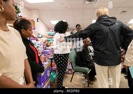 Opelika, Alabama, USA. 08th March, 2019. U.S President Donald Trump meets with residents at the Providence Baptist Church relief center March 8, 2019 in Smith Station, Alabama. The region was hit by a tornado on March 3rd killing 23 people. Credit: Planetpix/Alamy Live News - Stock Image