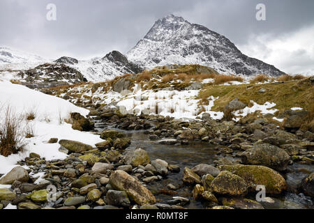 Tryfan is a mountain in the Glyderau Range in the Snowdonia National Park, Wales. It looks down on the Ogwen Valley, - Stock Image