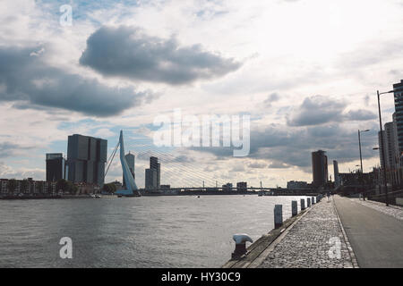City At Waterfront Against Cloudy Sky - Stock Image