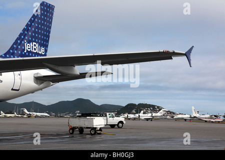 Tail and wing section of Jetblue Airbus A320 on the tarmac at Princess Juliana International Airport, St Maarten, - Stock Image