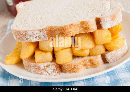 British chip butty potato chips or fries in a sandwich - Stock Image