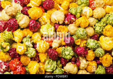 Colorful candy popcorn making a background - Stock Image