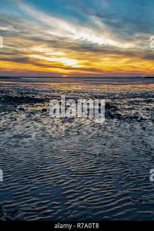 Sunset at low tide over the beach at Chatelaillon Plage near La Rochelle in the Charente-Maritime department of southwest France. - Stock Image