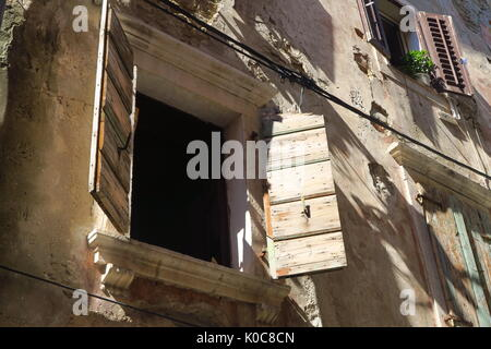 Shuttered windows on houses in the Slovenian town of Piran - Stock Image