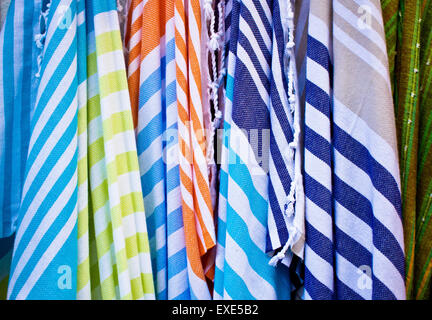 Colorful striped textiles as a background image - Stock Image