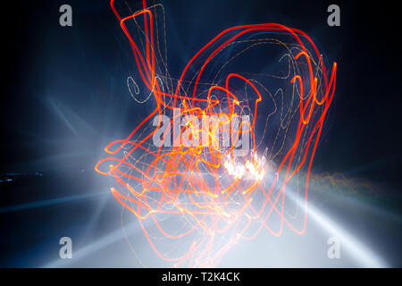 Light blurred pattern created from the movement of a car at night. - Stock Image