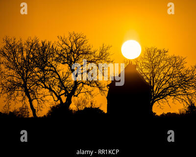 Sunrise and silhouette of tiny house, France. - Stock Image