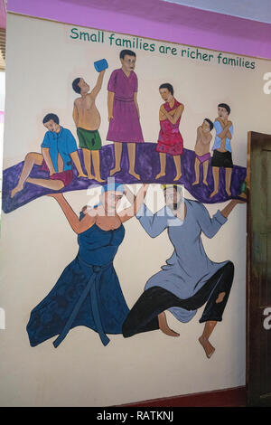 Small Families are Richer Families mural painting, Bwindi Community Hospital, Uganda, Africa - Stock Image