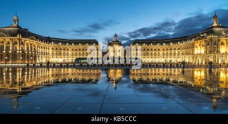 Place De La Bourse, water reflection, tram,  Bordeaux, UNESCO-Weltkulturerbe, Gironde,  Bordeaux, France - Stock Image