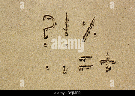 Punctuation marks written out in wet sand. Please see my collection for more similar photos. - Stock Image