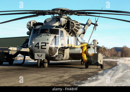 A U.S. Marine Corps CH-53 Super Stallion Helicopter sits connected to warming vents as it prepares for flight later - Stock Image