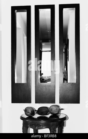 Artificial fruits on a stool - Stock Image